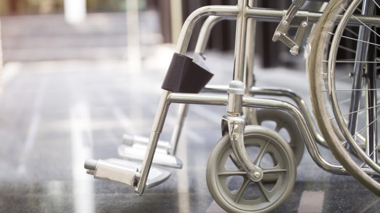 An aluminum wheel chair used by patients who are injured.