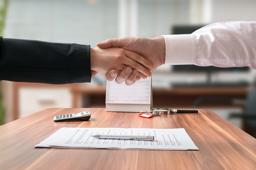 Two people shaking each others hands agreed on settling the case by mediation and arbitration.