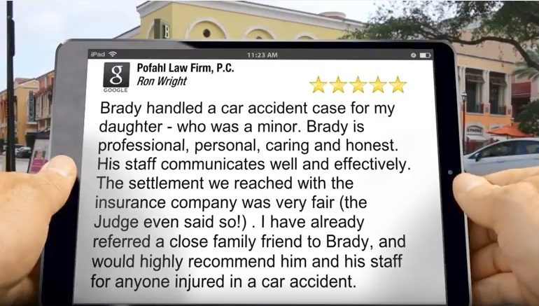 A person holding a tab reading a 5 star review about pofahl law firm in albuquerque new mexico
