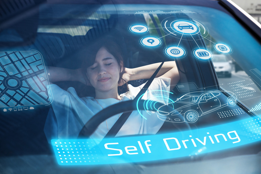 a women sleeping in her car in inclined position putting her two hands in the back of her head while her car is automatically self driving
