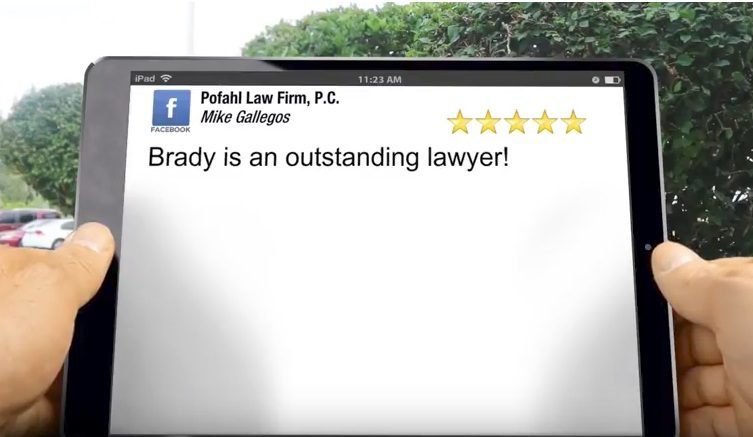 an image of a person holding an ipad with a 5 star review for Pofahl Law Firm