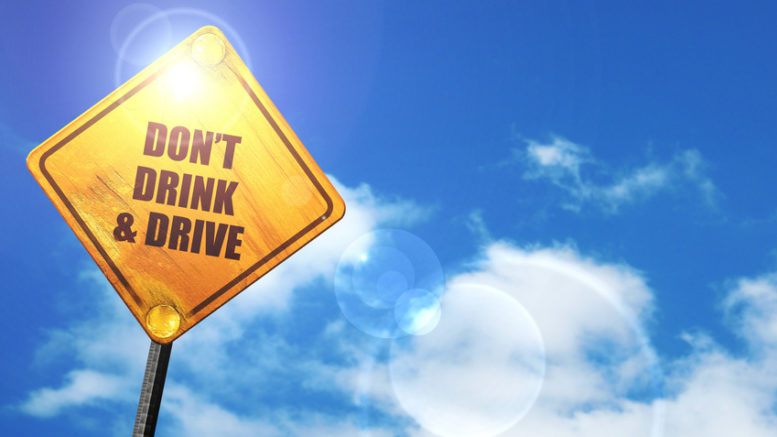 an image of a blue sky and a yellow sign with don't drink and drive written on it