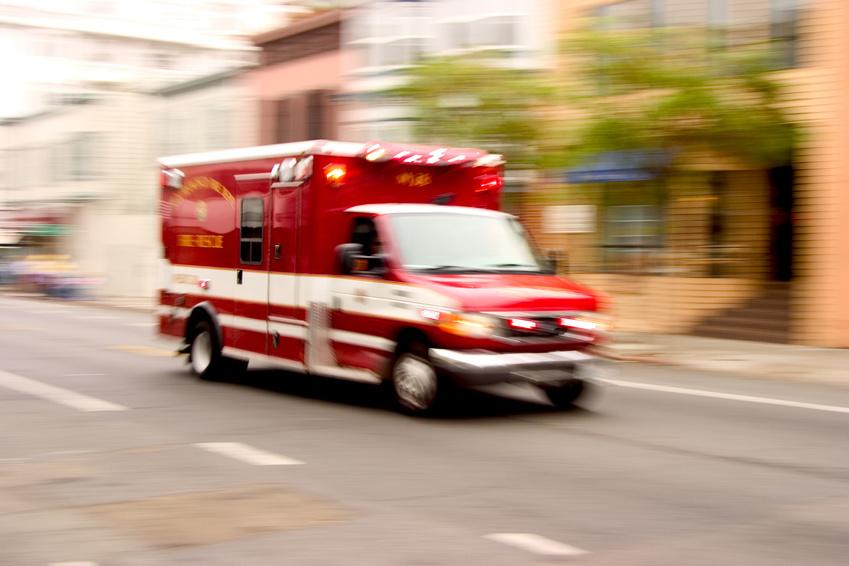 a speeding red ambulance